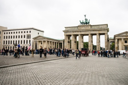BERLIN, GERMANY - SEPTEMBER 20:  Brandenburg Gate and Pariser Platz on September 20, 2013 in Berlin, Germany. Called Brandenburger Tor, its one of the few monuments that survived after Second World War.