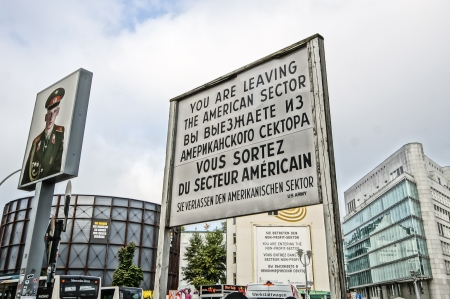 BERLIN, GERMANY - SEPTEMBER 21:   Checkpoint Charlie on September 21, 2013 in Berlin, Germany. Its the best-known Berlin Wall crossing point between East and West Berlin during the Cold War.