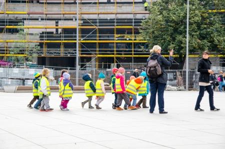 BERLIN, GERMANY - SEPTEMBER 19: Children excursion in Alexander Platz on September 19, 2013 in Berlin, Germany.