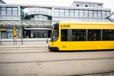 tramline: DRESDEN, GERMANY - SEPTEMBER 22: tram with passengers on September 22, 2013 in Dresden, Germany. The municipal company (DVB) operates twelve routes on a 200 km network.