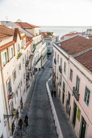 o jorge: LISBOA, PORTUGAL - NOVEMBER 28: Alfama street on November 28, 2013 in Lisbon, Portugal. It is the oldest district of Lisbon, spreading on the slope between the São Jorge Castle and the Tejo river. Editorial