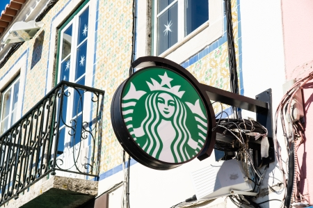 LISBOA, PORTUGAL - DECEMBER 1: Starbucks coffee on Belem District on December 1, 2013 in Lisbon, Portugal. The largest coffeehouse company in the world. Editorial