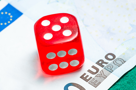 red dice and five euro