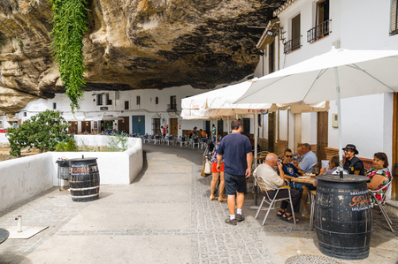 SETENIL DE LAS BODEGAS, SPAIN - SEPTEMBER 07: View of historic center on September 07, 2014 in Setenil de las Bodegas, Cadiz, Spain. Its centre is a typical Andalusian white-washed village.