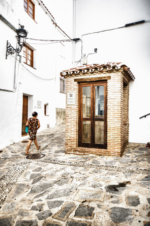 permanently: GENALGUACIL, SPAIN - SEPTEMBER 07: View of historic center on September 07, 2014 in Genalguacil, Malaga, Spain. Every two years, artists from all over doing different pieces of art that also leave permanently exposed in the streets.