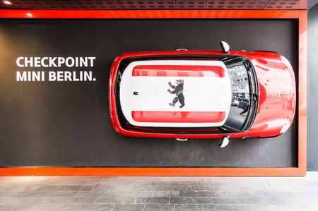 dealerships: BERLIN, GERMANY - SEPTEMBER 17: Mini dealerships in Friedrichstrasse near Checkpoint Charlie on September 17, 2013 in Berlin, Germany.