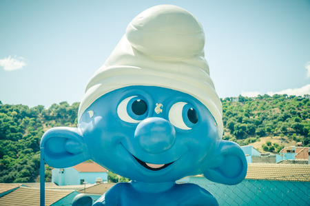 JUZCAR, SPAIN - SEPTEMBER 07: View of Juzcar on September 07, 2014 in Juzcar, Malaga, Spain. In spring 2011, buildings in the town were painted smurf-blue by Sony Pictures to celebrate the premiere of the Smurfs movie.