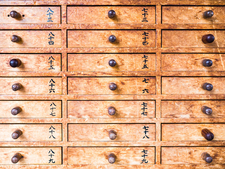 oracle: TOKYO, JAPAN - MARCH 18: Detail of oracle (omikuji) stalls at Sensoji Temple on March 18, 2015 in Tokyo, Japan.