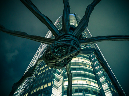 mori: TOKYO, JAPAN - MARCH 21: Spider sculpture in Roppongi Hills on March 21, 2015 in Tokyo, Japan. This sculpture is outside of Mori Tower.