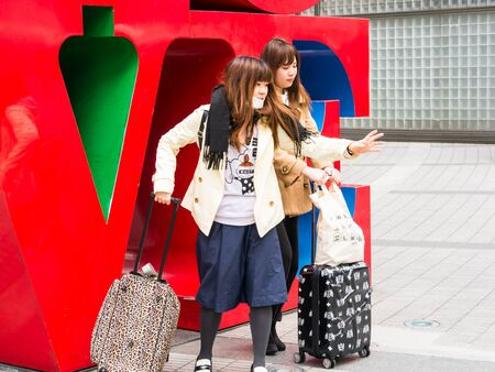 public project: TOKYO, JAPAN - MARCH 31: Love Sculpture on March 31, 2015 in Tokyo, Japan.Designed by Robert Indiana sculpture is a part of Shinjuku I-Land public art project.