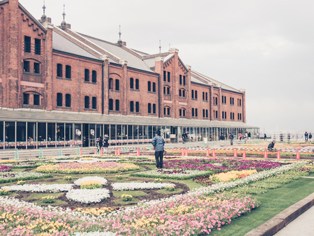warehouse building: YOKOHAMA, JAPAN - MARCH 22: Yokohama Red Brick Warehouse on March 22, 2015 in Yokohama, Japan. It is a historical building that is used as a complex that includes a shopping mall, banquet hall, and event venues.