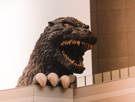 TOKYO, JAPAN - MARCH 31: Godzilla statue in Shibuya district on March 31, 2015 in Tokyo, Japan. It is a giant monster or daikaiju originating from a series of tokusatsu films of the same name from Japan.
