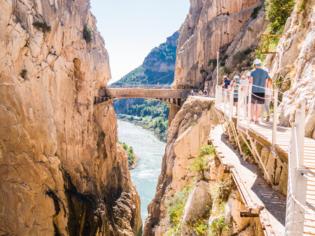 ARDALES (MALAGA), SPAIN – SEPTEMBER 27: Tourists walk along the 'El Caminito del Rey' (King's Little Path) on September 27, 2015 in Ardales, Spain. This famous footpath was reopened in May 2015.