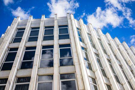 from below: MALAGA, SPAIN - JANUARY 16: Office building from below at daytime on January 16 in Malaga, Spain.