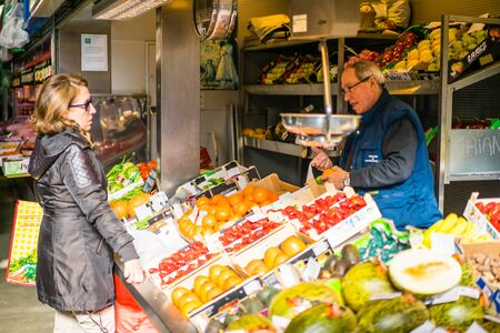 central market: MALAGA, SPAIN - JANUARY 16: Woman buying food at central market on January 16 in Malaga, Spain. It was renovated in 2010 and it was reopened on March 2011.