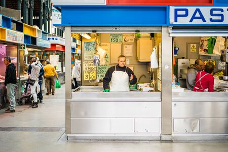 central market: MALAGA, SPAIN - JANUARY 16: A man working with fish at central market on January 16 in Malaga,Spain.
