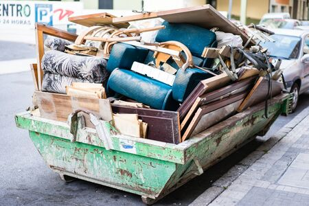 TORREMOLINOS, SPAIN - JANUARY 18: Dust-cart full of useless furniture on January 18 in Torremolinos, Spain Editorial