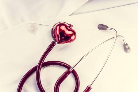 overall: Stethoscope and decorative red heart on white doctors overall
