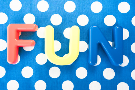 plastic made: Fun made of plastic letters, blue dotted background