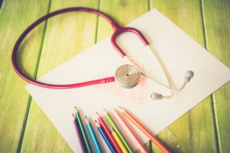 altimeter: Close-up of painted heart and stethoscope on white background