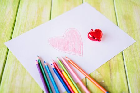 Painted red heart and Christmas heart on paper