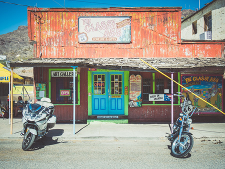 mining town: OATMAN, USA - SEPTEMBER 06: Oatman street on September 06, 2015 in Oatman, California, United States. Oatman is a former mining town in the Black Mountains of Mohave County.
