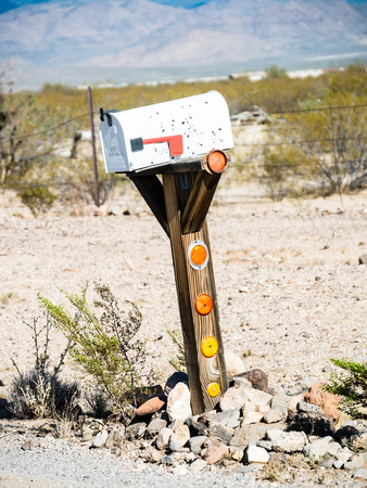united states postal service: ARIZONA, USA - SEPTEMBER 06: Old mailboxes in historic Route 66 on September 06, 2015 in Arizona, United States. Route 66 was established on November 11, 1926