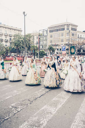 falla: VALENCIA,SPAIN - MARCH 18: Several unidentified women walk in the offering of Fallas, one of the biggest parties in Spain on March 18,2016 in Valencia,Spain.