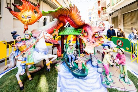 fallas: ALZIRA,SPAIN - MARCH 17: Las Fallas,papermache models are constructed then burnt in the traditional celebration in praise of St Joseph on March 17,2016 in Alzira,Valencia,Spain. Editorial