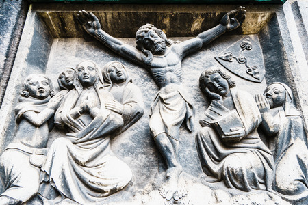 Close-up of scene of Jesus crucifixion carved on stone