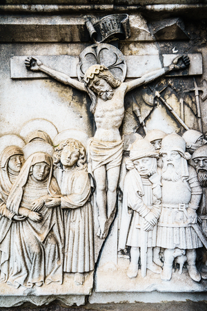 crucify: Close-up of scene of Jesus crucifixion carved on stone