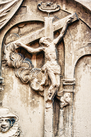 vetical: Close-up of scene of Jesus crucifixion carved on stone