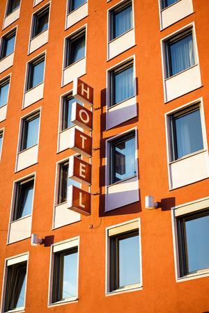hotel building: Hotel signboard on building facade