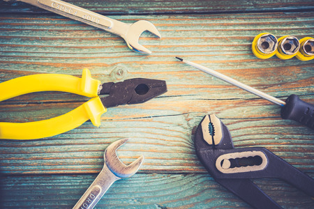 close up  wrench: Close-up of different working tools on wooden table Stock Photo