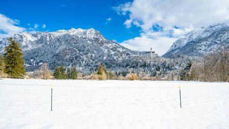 beautiful location: Beautiful view on Neuschwanstein castle in snowy forest