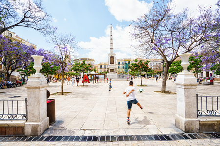 merced: MALAGA,SPAIN - 28 MAY 2016: View on Merced square with kids playing football