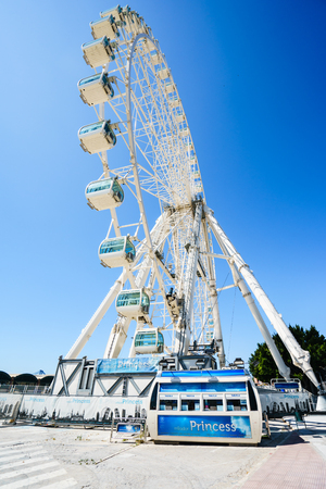 MALAGA,SPAIN - 28 MAY 2016:View on enormous ferris wheel against of blue sky in sunlight
