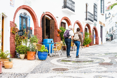 nerja: FRIGILIANA, SPAIN - JANUARY 30: picturesque street of Frigiliana on January 30, 2016 Frigiliana, Spain. It is one of beautiful white towns in Axarquia Area, Andalusia.