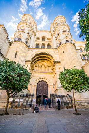 MALAGA, SPAIN - JANUARY 16: View of Malaga cathedral with tourists on January 16, 2016 in Malaga, Spain. It was constructed between 1528 and 1782.