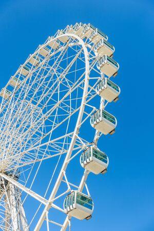 big wheel: Close-up of swirling big wheel against of blue sky