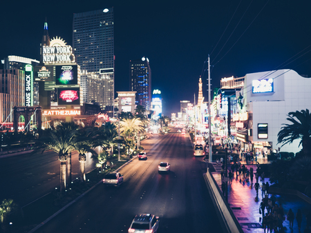 internationally: LAS VEGAS, USA - SEPTEMBER 08: Unidentified tourists in the strip on September 08, 2015 in Las Vegas, United States. It is an internationally renowned major resort city known primarily for gambling, shopping, fine dining and nightlife. Editorial