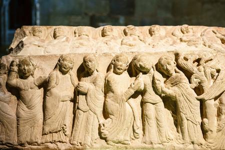 LA RIOJA,SPAIN - 29 AUGUST,2016: Stone bas-relief with women in sunlight in Santa Maria Monastery in Najera.