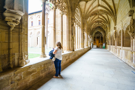 LA RIOJA,SPAIN - 29 AUGUST,2016: Back view of female tourist walking along hall with gothic architecture