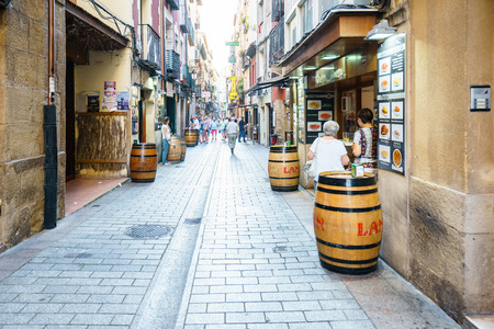 LA RIOJA,SPAIN - 29 AUGUST,2016:View of paved sidewalk with tourists walking along in daylight Editorial