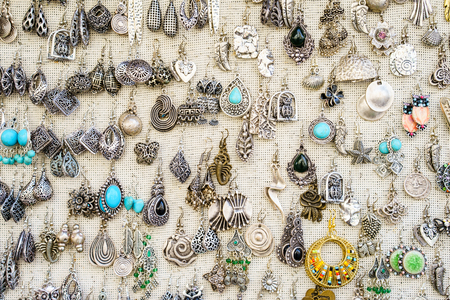 silver jewelry: Close-up of jewelry market with silver earrings