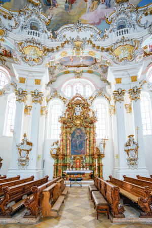 rococo: WIESKIRCHE, GERMANY – MARCH 07: View on rococo interior of chapel with benches on March 07, 2016 in Wieskirche, Germany.