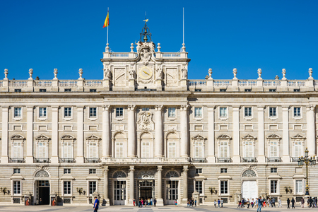 municipal editorial: Royale Palace, Madrid, Spain - 09.10.2016. Big square by aged palace.