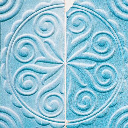 The two halves of blue colored tile ornament with the shear. Reklamní fotografie
