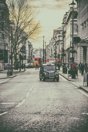 hackney carriage: LONDON, UK - 20 FEBRUARY, 2017: Typical street scene in central London with taxi cab Editorial