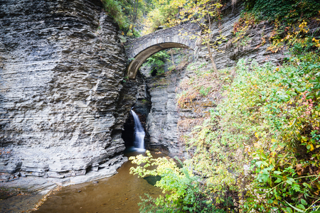 outoors: A view to small fall under bridge in gorge in Watkins Glen State Park, Finger Lakes, USA